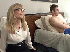 Big Bust cougar Nina Hartley seduces close by stockings and a garter