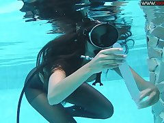 Girl in scuba with along to addition of pantyhose Diana Kalgotkina is toying pussy under along to water