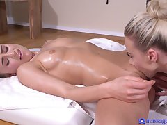 A hot Lez girl scissors with a busty massuse in the massage room